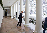 """Dec. 19, 2009<br /> """"Snowball in hand, the President chases Chief of Staff Rahm Emanuel on the White House colonnade. To escape, Rahm ran through the Rose Garden, which unfortunately for him, was knee-deep in snow.""""<br /> (Official White House photo by Pete Souza)<br /> <br /> This official White House photograph is being made available only for publication by news organizations and/or for personal use printing by the subject(s) of the photograph. The photograph may not be manipulated in any way and may not be used in commercial or political materials, advertisements, emails, products, promotions that in any way suggests approval or endorsement of the President, the First Family, or the White House."""