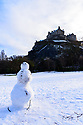 A socially distanced snowman enjoys the festive weather in Edinburgh's Princes Street Gardens, in front of Edinburgh Castle. This is the first snowfall of the first Covid Winter in Edinburgh. Edinburgh has been placed in Tier 4 restrictions due to the Covid-19 pandemic