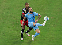 WASHINGTON, DC - SEPTEMBER 06: Ola Kamara #9 of D.C. United defends Maxime Chanot #4 of New York City FC during a game between New York City FC and D.C. United at Audi Field on September 06, 2020 in Washington, DC.