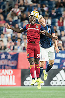 FOXBOROUGH, MA - SEPTEMBER 21: Sam Johnson #50 of Real Salt Lake and Antonio Mlinar Delamea #19 of New England Revolution compete for a high ball during a game between Real Salt Lake and New England Revolution at Gillette Stadium on September 21, 2019 in Foxborough, Massachusetts.