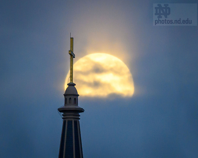 February 26, 2021; Moon rises behind the Basilica of the Sacred Heart cross (Photo by Matt Cashore/University of Notre Dame)