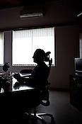A silhouette of 58 year old heart surgeon, Dr. Devi Prasad Shetty is seen in his office at the Narayana Hrudayalaya in Bangalore, Karnataka, India. Photo: Sanjit Das/Panos