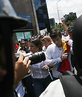 Venezuela: Caracas,18/02/14 <br /> Leopoldo Lopez accompained  with Maria Corina Machado,arrives to a the rally in support of himself in Plaza Brion in Chacaíto, Caracas. Lopez was then handed to the National Guard, because the government had issued an arrest warrant against him responsible for the violence of the protest 12F, where two students and a member of a pro-government paramilitary group died. <br /> Adolfo Acosta/Archivolatino