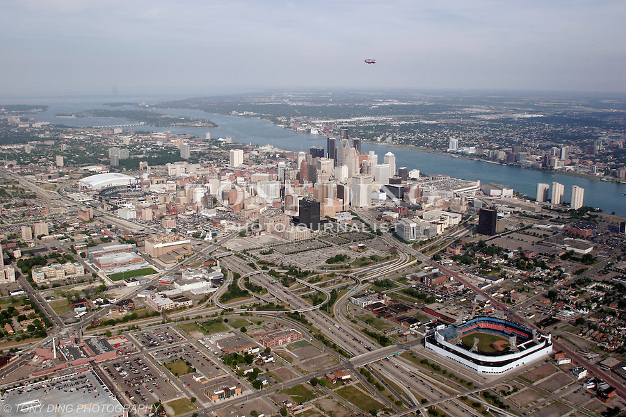 """Aerial photograph of downtown Detroit, Mich. taken from on board the Akron, Ohio based """"Spirit of Goodyear"""" airship on Monday, July 11, 2005 as it headed out to the start of the 2005 Major League Baseball All-Stars Homerun Derby at Comerica Park (Photo by Tony Ding)"""