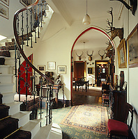 The Victorian entrance hall at Glentruim is decorated with hunting trophies and stuffed birds