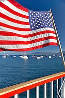 American flag on back of boat at Lake Tahoe. California