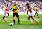 Nederland, Amsterdam, 19 april 2015<br /> Eredivisie<br /> Seizoen 2014-2015<br /> Ajax-NAC Breda (0-0)<br /> Demy de Zeeuw van NAC Breda en Jairo Riedewald van Ajax strijden om de bal