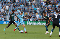 ST PAUL, MN - AUGUST 14: Kevin Cabral #9 of the Los Angeles Galaxy and Wil Trapp #20 of Minnesota United FC battle for the ball during a game between Los Angeles Galaxy and Minnesota United FC at Allianz Field on August 14, 2021 in St Paul, Minnesota.