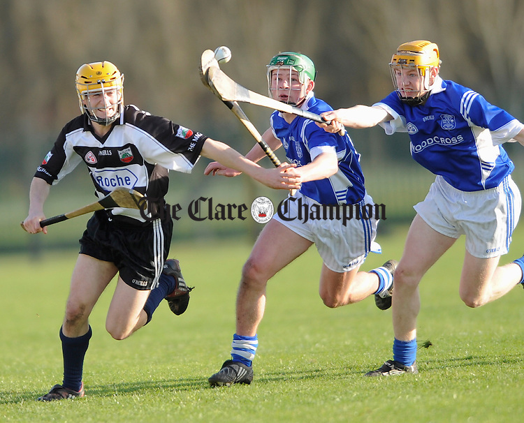 Clarecastle's Thomas Donnellan comes under pressure from Cratloe's Joesph O Connor and Joe Conroy during their U-21 Championship game at Shannon. Photograph by John Kelly.