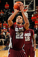 CHARLOTTESVILLE, VA- December 27: Ron Spencer #22 of the Maryland-Eastern Shore Hawks shoots the ball during the game against the Virginia Cavaliers on December 27, 2011 at the John Paul Jones Arena in Charlottesville, Va. Virginia defeated Maryland Eastern Shore 69-42.  (Photo by Andrew Shurtleff/Getty Images) *** Local Caption *** Ron Spencer