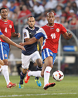 USMNT forward Landon Donovan (10) in pursuit. In CONCACAF Gold Cup Group Stage, the U.S. Men's National Team (USMNT) (blue/white) defeated Costa Rica (red/blue), 1-0, at Rentschler Field, East Hartford, CT on July 16, 2013.