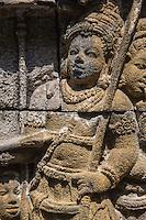 Borobudur, Java, Indonesia.  Detail of Bas-relief Stone Carving Representing Scene from Javanese Hindu-Buddhist Mythology.