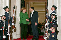 Pictured: German Chancellor Angela Merkel is greeted Greek Prime Minister Alexis Tsipras on the steps of Maximou Mansion (Megaro Maximou) in Athens, Greece.<br /> Re: Official visit of German Chancellor Angela Merkel  to Athens, Greece.