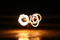 Fire Twirler on Nobby's Beach during the lunar eclipse at Newcastle, New South Wales