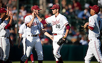 STANFORD, CA - April 21, 2011: Mark Appel of Stanford baseball is congratulated at the dugout after a scoreless inning during Stanford's game against UCLA at Sunken Diamond. Stanford won 7-4.