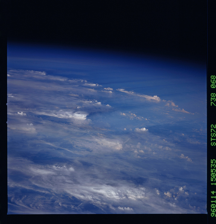 John Angerson. STS-72 Book.<br /> Public Domain Image.<br /> NASA images Courtesy National Archives - Record Group number: 255-STS-STS072<br /> <br /> Description: Earth observations taken from shuttle orbiter Endeavour during STS-72 mission.<br /> <br /> Subject Terms: STS-72, ENDEAVOUR (ORBITER), EARTH OBSERVATIONS (FROM SPACE), EARTH LIMB<br /> <br /> Date Taken: 1/14/1996<br /> <br /> Categories: Earth Observations<br /> <br /> Interior_Exterior: Exterior<br /> <br /> Ground_Orbit: On-orbit<br /> <br /> Original: Film - 70MM CT<br /> <br /> Preservation File Format: TIFF<br /> <br /> geon: CLOUDS<br /> <br /> feat: PAN-CLOUDS, THUNDERSTORMS<br /> <br /> tilt: High Oblique<br /> <br /> cldp: 100<br /> <br /> nlat: -22.2<br /> <br /> nlon: 42.3<br /> <br /> azi: 251<br /> <br /> alt: 164<br /> <br /> elev: 1