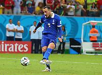 Konstantinos Mitroglou of Greece scores his penalty in the shootout