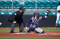 Western Carolina Catamounts catcher Michael Goehrig (10) receives a high pitch as home plate umpire Andrew Glenn looks on during the game against the Kennesaw State Owls at Springs Brooks Stadium on February 22, 2020 in Conway, South Carolina. The Owls defeated the Catamounts 12-0.  (Brian Westerholt/Four Seam Images)