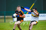 Darragh O'Brien Austin Stacks gets to the ball ahead of David Naughton  Dr Crokes during their Div1 County League game in Lewis Road on Saturday