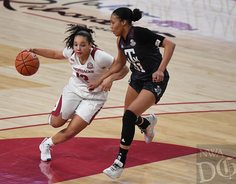 Arkansas' Destiny Slocum drives downcourt while Texas A&M's N'dea Jones defends Sunday Jan. 10, 2021 at Bud Walton Arena in Fayetteville. Arkansas lost 74-73. Visit nwaonline.com/210111Daily/ and nwadg.com/photos. (NWA Democrat-Gazette/J.T. Wampler)