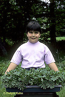 HB03-151x  Child with marigold seedlings ready for transplanting