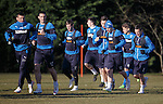 The Rangers old guard of Lee McCulloch and Lee Wallace lead the players around at training