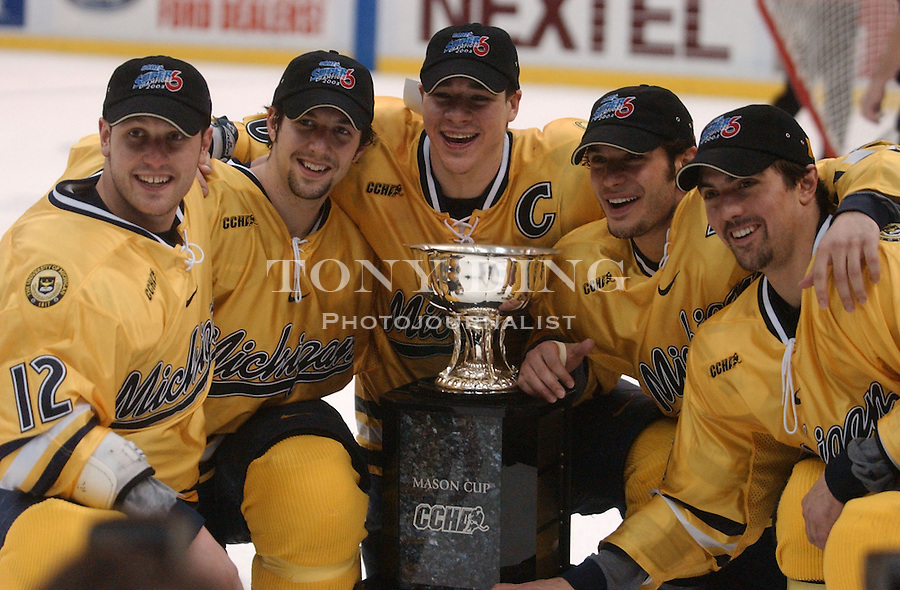 Michigan Hockey seniors pose around the Mason Cup after the Wolverines beat Ferris State for the CCHA Conference Championship on Saturday, March 22, 2003 at Joe Louis Arena in Detroit, Mich (Tony Ding/Daily).