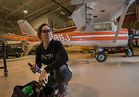 Aviation Maintenance Technology student Kaasan Braendel retrieves tools as she prepares to disassemble and inspect the landing gear on a Cessna 150 during AMT 273 Aircraft Fluid Power Systems at UAA's Aviation Technology Complex on Merrill Field.