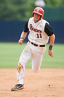 Greg Hopkins #11 of the St. John's Red Storm hustles towards third base against the Ole Miss Rebels at the Charlottesville Regional of the 2010 College World Series at Davenport Field on June 6, 2010, in Charlottesville, Virginia.  The Red Storm defeated the Rebels 20-16.  Photo by Brian Westerholt / Four Seam Images