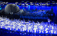 """27 JUL 2012 - LONDON, GBR - A giant baby is formed to celebrate the Scottish pioneers of obstetric ultrasound imaging during the """"Second To The Right, And Straight On Till Morning"""" section of the Opening Ceremony of the London 2012 Olympic Games in the Olympic Stadium in the Olympic Park, Stratford, London, Great Britain .(PHOTO (C) 2012 NIGEL FARROW)"""