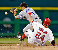 12 June 2006: Nick Johnson, first baseman for the Washington Nationals, doubles to left field and slides safely into second in the fourth inning against the Colorado Rockies at RFK Stadium, in Washington, DC. The Nationals fell to the Rockies 4-3 in the first game of the four game series...Mandatory Photo Credit: Ed Wolfstein Photo..