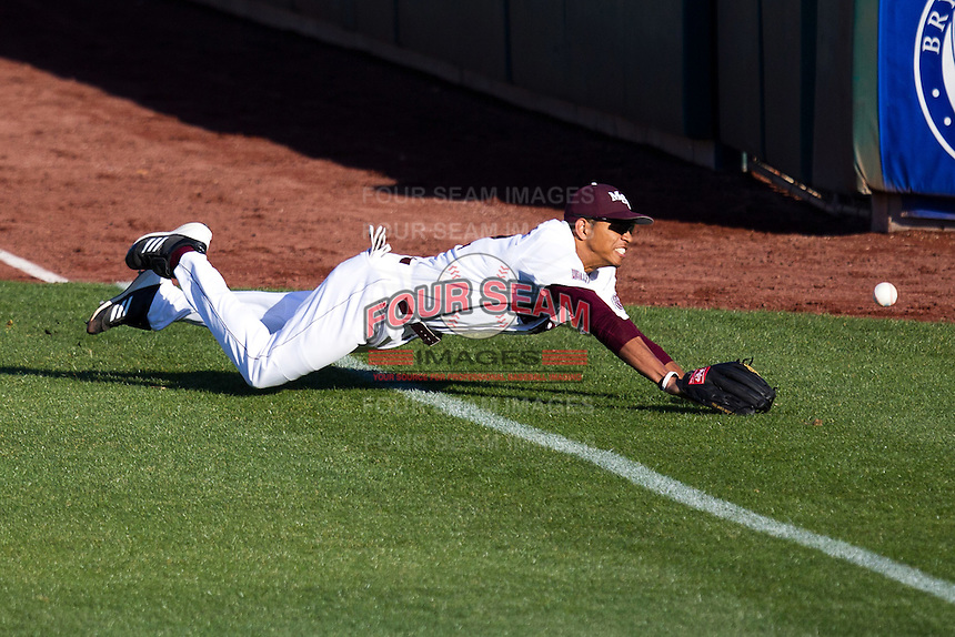 Trey Massenberg (12) of the Missouri State Bears dives and misses a ball in foul territory during a game against the Southern Illinois University- Edwardsville Cougars at Hammons Field on March 9, 2012 in Springfield, Missouri. (David Welker / Four Seam Images)