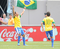 Brazil midfielder Romulo (8) celebrates his score in the 23ht minute of the game. The Argentina National Team defeated Brazil 4-3 at MetLife Stadium, Saturday July 9 , 2012.