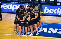 The Silver Ferns huddle during the Cadbury Netball Series Taini Jamison Trophy match between New Zealand Silver Ferns and England Roses at Claudelands Arena in Hamilton, New Zealand on Wednesday, 28 October 2020. Photo: Dave Lintott / lintottphoto.co.nz