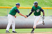 Gookie Dawkins #9 of the Charlotte Knights is congratulated by Charlotte Knights manager Joe McEwing #11 as he rounds third base following his 2-run home run in the 7th inning against the Syracuse Chiefs at Knights Stadium on June 19, 2011 in Fort Mill, South Carolina.  The Knights defeated the Chiefs 10-9.    (Brian Westerholt / Four Seam Images)