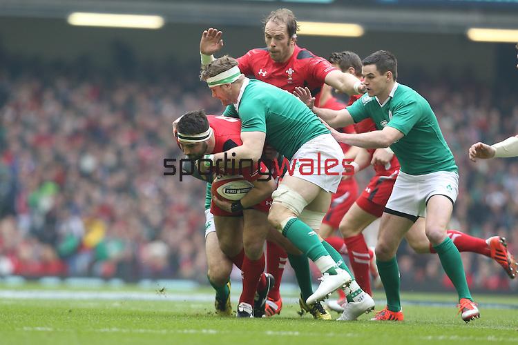 Ireland number 8 Jamie Heaslip stops Wales hooker Scott Baldwin.<br /> RBS 6 Nations<br /> Wales v Ireland<br /> Millennium Stadium<br /> 14.03.15<br /> ©Steve Pope - SPORTINGWALES