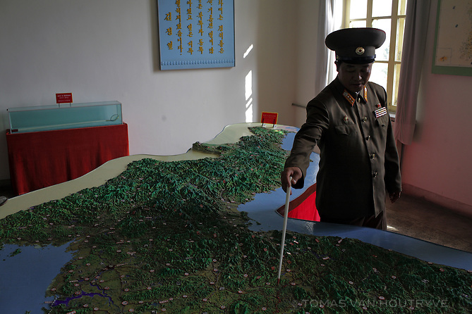 A North Korean soldier points out the DMZ, the de-militarized zone that serves as the border between North and South Korea on a scale model of the Korean peninsula in Pyongyang, North Korea (DPRK) on 24 August, 2007.