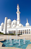 Fountains at the beautiful white Sheikh Zayed Grand Mosque in Abu Dhabi in the UAE the worlds 8th largest Muslim mosque in the world in United Arab Emirates