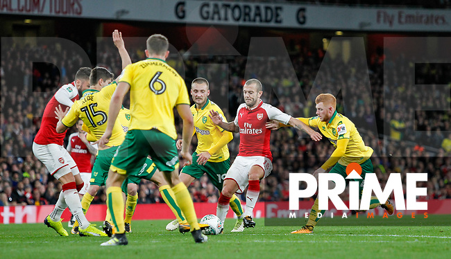 Jack Wilshere of Arsenal battles through Norwich City players during the Carabao Cup match between Arsenal and Norwich City at the Emirates Stadium, London, England on 24 October 2017. Photo by Carlton Myrie.