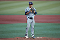 Old Dominion Monarchs relief pitcher Jacob Gomez (43) looks to his catcher for the sign against the Charlotte 49ers at Hayes Stadium on April 23, 2021 in Charlotte, North Carolina. (Brian Westerholt/Four Seam Images)
