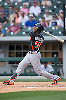 Henry Urrutia (51) of the Norfolk Tides follows through on his swing against the Charlotte Knights at BB&T BallPark on June 7, 2015 in Charlotte, North Carolina.  The Tides defeated the Knights 4-1.  (Brian Westerholt/Four Seam Images)