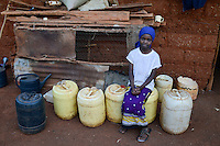 KENYA, Mount Kenya East , Region South Ngariama, extreme drought due to lack of rain has caused massive water problems, villager must transport water over long distances with jerry cans,  girl Naomi Waithira / KENIA, Duerre,  Wasser muss ueber weite Entfernungen geholt werden, Maedchen Naomi Waithira mit Kanistern