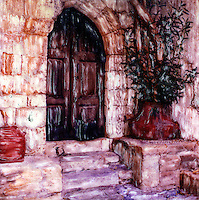 The gothic brown door and stone steps combined with the warmth of the Grecian sun welcomes us.