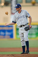 Starting pitcher Nick Barnese #27 of the Charlotte Stone Crabs uses the rosin bag during a Florida State League game against he Jupiter Hammerheads at Roger Dean Stadium June 16, 2010, in Jupiter, Florida.  Photo by Brian Westerholt /  Seam Images