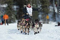 Kelley Griffin runs on Long Lake past picnicing spectators during the restart of the Iditarod sled dog race in Willow, Alaska Sunday, March 3, 2013.