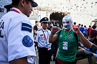 Moscow, Russia, 15/06/2018.<br /> A Mexico supporter in a wrestling mask talking to Mexican police in central Moscow during the 2018 FIFA World Cup.