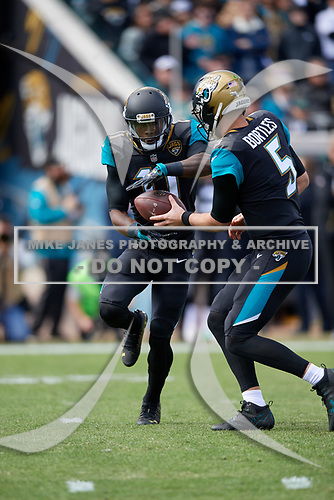 Jacksonville Jaguars Marqise Lee (11) takes the handoff from quarterback Blake Bortles (5) during an NFL Wild-Card football game against the Buffalo Bills, Sunday, January 7, 2018, in Jacksonville, Fla.  (Mike Janes Photography)