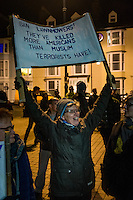 "Hundreds of people gather to show their solidarity against US President Trump's so called ""Muslim Ban"" on Aberystwyth seafront, Wales, UK. Monday 30 January 2017"