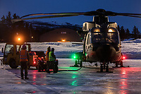British Merlin helicopter about to go on a night time sortie, part of their Arctic training, over the terrain near Bardufoss, Norway. <br /> <br /> 845 Naval Air Squadron is a squadron of the Royal Navy's Fleet Air Arm. Part of the Commando Helicopter Force, it is a specialist amphibious unit operating the Leonardo Commando Merlin Mk3 helicopter and provides troop transport and load lifting support to 3 Commando Brigade Royal Marines.<br /> <br /> ©Fredrik Naumann/Felix Features