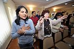 Women pray during a worship service of the United Methodist Roma congregation in Jabuka, Serbia..